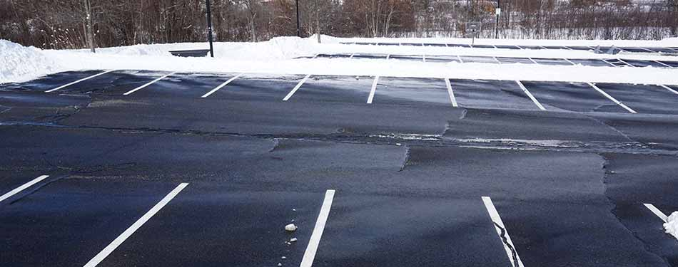 Professionally administered snow removal and deicing of a commercial parking lot in Bloomington-Normal, IL.
