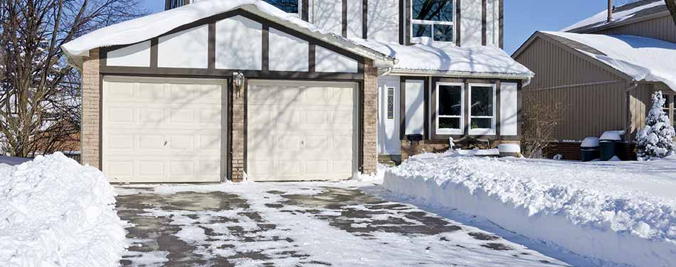 Bloomington-Normal, IL home benefiting from the professional snow removal service that J.T. & Sons Lawn Care now offers to residents in the area.