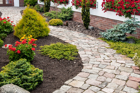 Professionally installed landscaping and hardscaping by J.T. & Sons Lawn Care in Bloomington, IL