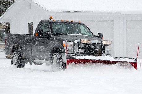 J.T. & Sons Lawn Care performing snow removal service in Bloomington, IL