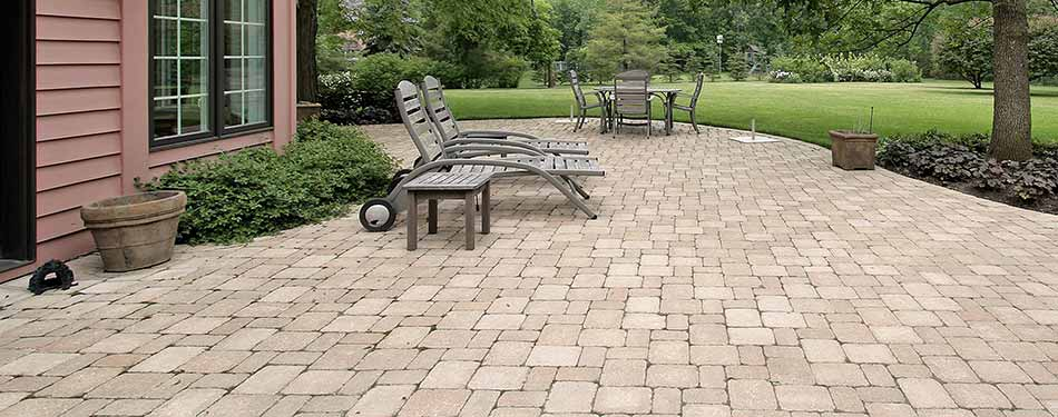 Concrete paver patio installed by J.T. & Sons Lawn Care exemplifies their new landscaping & hardscaping service available to residents in the Bloomington-Normal, IL area.