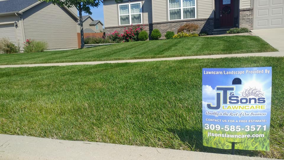 J.T. & Sons Lawn Care mowing lawn in Normal, IL.